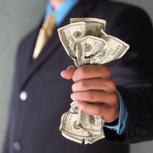Man's hand holding cash